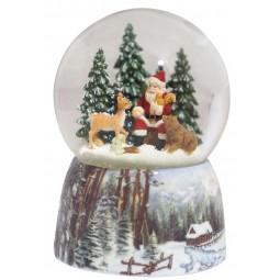 Boule de neige Père Noël dans la forêt