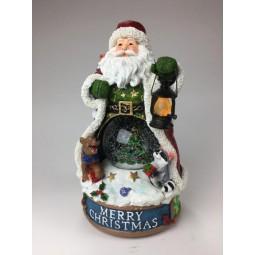 Père Noël avec boule de neige