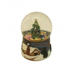 Boule avec paillettes scintillantes enfants sous le sapin de Noël