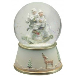 Snow globe Santa on rocking horse