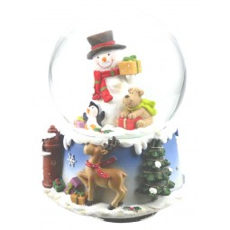 Boule de neige bonhomme de neige, chien et pingouin