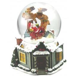 Boule Père Noël dans son traîneau avec neige et paillettes
