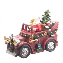 Père Noël dans sa voiture ancienne