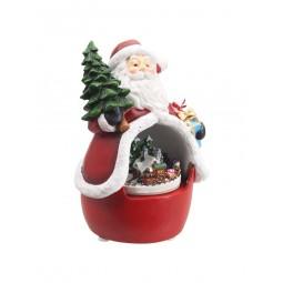 Père Noël avec scène de train