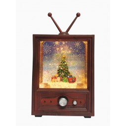 Télé avec boule scintillante