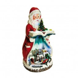 Père Noël avec livre et scène de train sous le pan du manteau