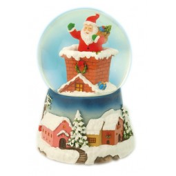 Boule de neige Père Noël dans la cheminée
