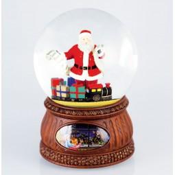 Boule de neige Père Noël avec liste et cadeaux
