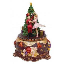 Casse-noisettes et ballerine près du spin de Noël