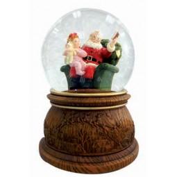 Boule de neige Père Noël qui lit à haute voix