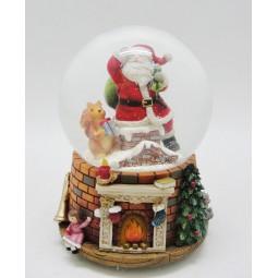 Boule de neige Père Noël sortant de la cheminée