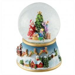 Scène décoration du sapin de Noël dans une boule de neige