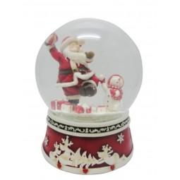 Boule de neige Père Noël lançant un ballon