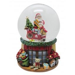 Boule de neige Père Noël et garçon près du traîneau
