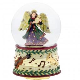 Boule de neige ange avec harpe sur socle avec instruments de musique et notes