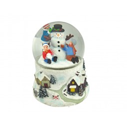 Boule de neige enfants et bonhomme de neige